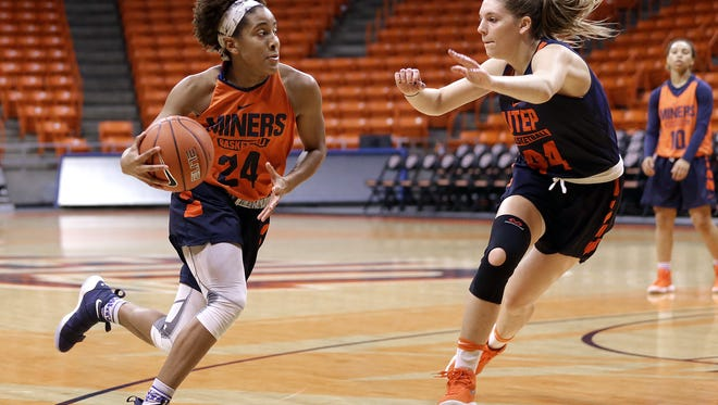 UTEP's Rachel Tapps, left, drives to the basket covered by teammate Katarina Zec on Tuesday at the Don Haskins Center as they prepare for their game Thursday against UNM.