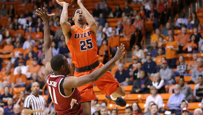 UTEP's Keith Frazier shoots over NMSU's Johnathon Wilkins in the first half of their game Thursday at the Don Haskins Center in El Paso.