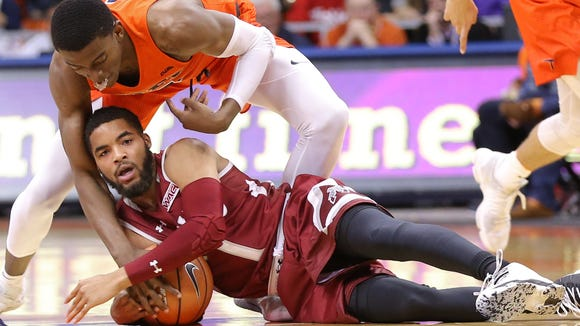 UTEP's Trey Wade wrestles for possession against NMSU's