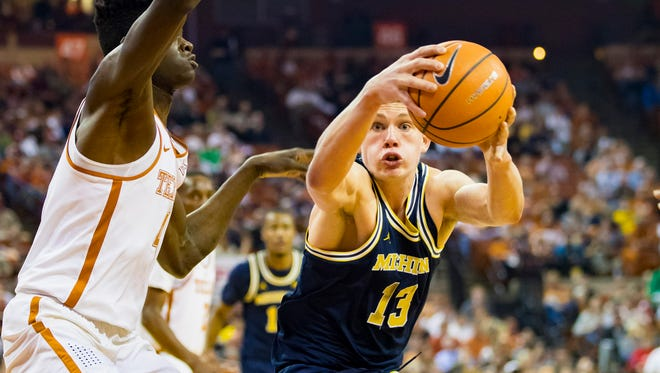 Michigan forward Moritz Wagner (13) controls the ball against Texas forward Mohamed Bamba (4) during the first half on Tuesday, Dec. 12, 2017, in Austin, Texas.