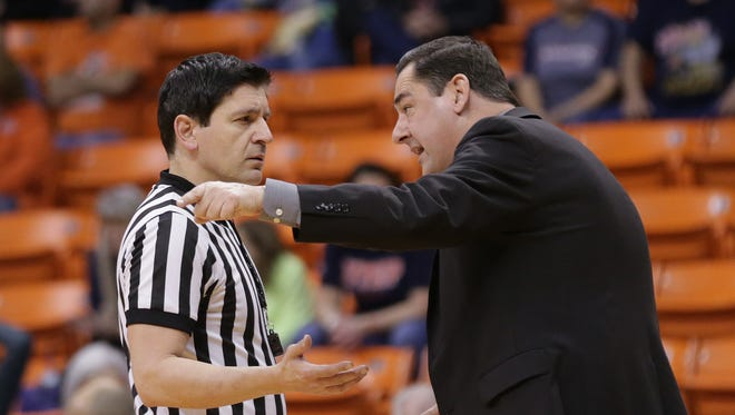 UTEP coach Kevin Baker talks to an official during Saturday's game against Middle Tennessee at the Don Haskins Center.