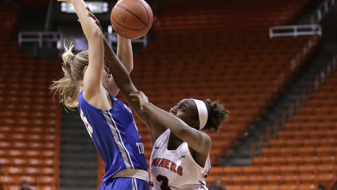 UTEP's Jordan Alexander collides with Middle Tennessee's Anna Jones during their game Saturday at the Don Haskins Center. UTEP fell to the Blue Raiders, 54-45.