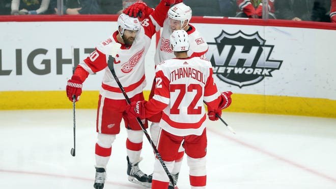 "Red Wings captain Henrik Zetterberg (40) wants to see less ""poke and hope"" hockey from teammates Andreas Athanasiou (72) and Anthony Mantha (39)."