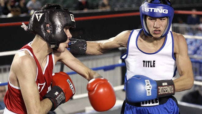 Diego Monclova, right, of the Alpine Boxing Club connects to the face of Andres Perez of Warrior's Edge during their Golden Gloves bout Saturday at the El Paso County Coliseum. Madrid would fight his way back to a win over Garcia in their 132lb. bout.