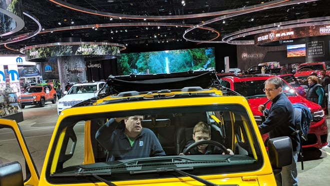 Oliver Hanawalt sits in the drivers seat of the 2018 Rubicon 4-door Jeep Wrangler at the Detroit Auto Show, Sunday, Jan.28, 2018.