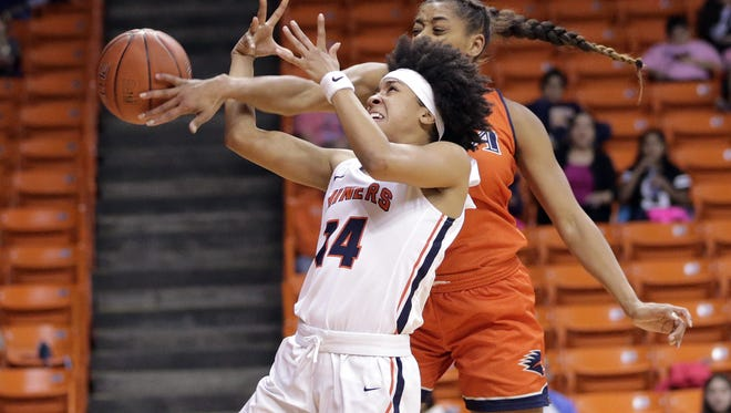 UTSA's Marie Benson was called for a technical foul on UTEP's Najala Howell as Howell was about to score on a fast break Friday night at the Don Haskins Center.