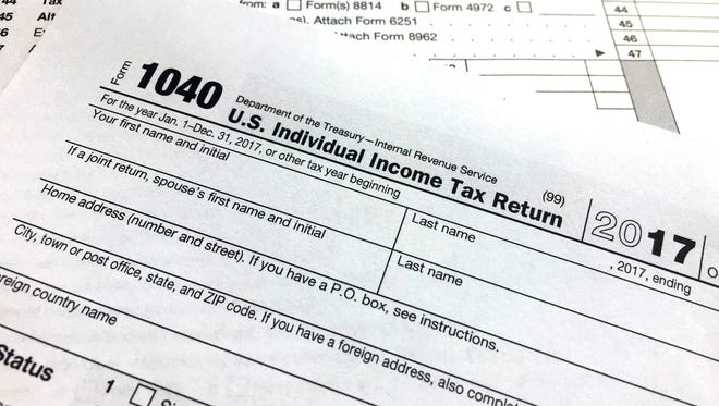 An IRS 1040 form, U.S. Individual Income Tax Return, is shown on Thursday, April 5, 2018, in New York.