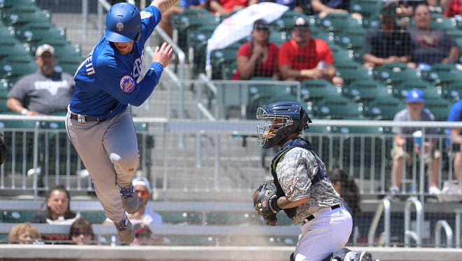 Zach Borensten of Las Vegas is able to sneak past El Paso catcher Raffy Lopez to score during their matinee game Monday at Southwest University Park.