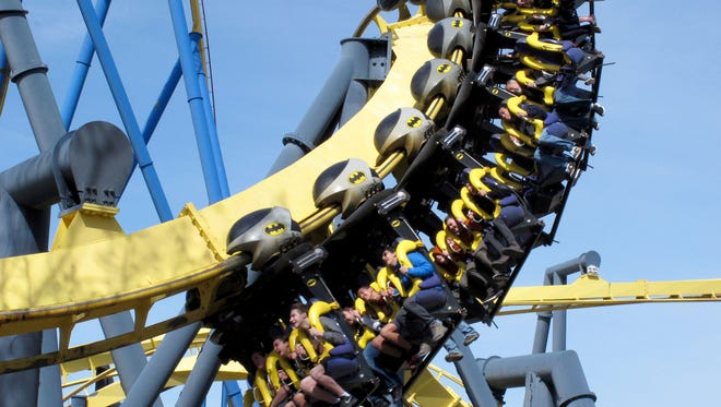 People fly on the Batman ride at Six Flags Great Adventure in Jackson Township Saturday, April 21, 2018.
