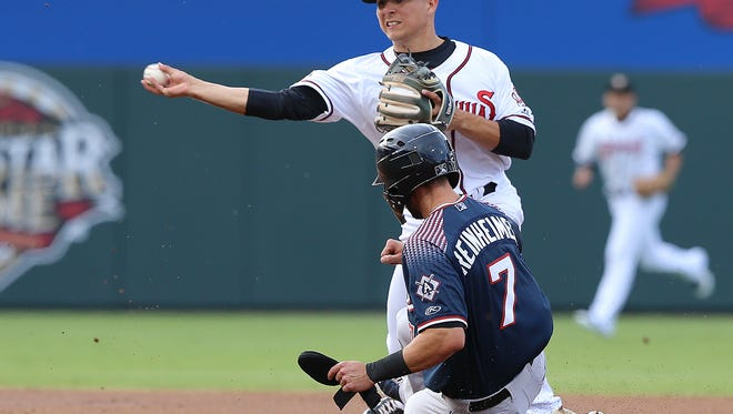 El Paso's Luis Urias turns a double play as Reno's Jack Reinheimer slides into second Tuesday night at Southwest University Park.