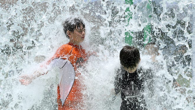 Kids flock to area splash pads to cool down as temperatures in El Paso near the triple digits.