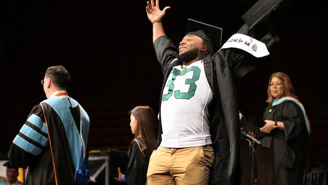 Green Bay Packer running back and all-time UTEP rushing leader Aaron Jones celebrates after receiving his diploma Saturday at the Don Haskins Center. Jones promised his family he would continue college and receive a degree when he declared for the draft.