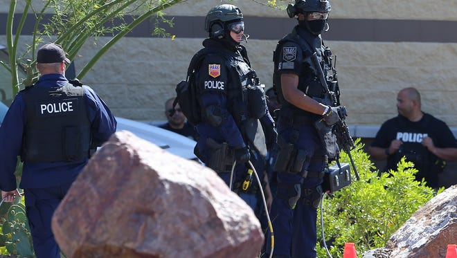 El Paso police SWAT team at the scene of a May 17  standoff with a suicidal man in parking lot of the North Hills Crossing shopping center.