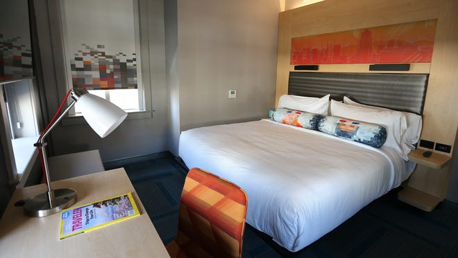 Most of the Aloft Hotel's 89 rooms are small but comfortable with views of nearby Downtown buildings.