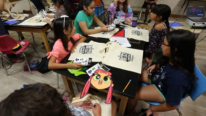 """The characters from the movie """"Teen Titans Go!"""" visit children in the Latinitas Summer Camp at El Paso Leadership Academy."""