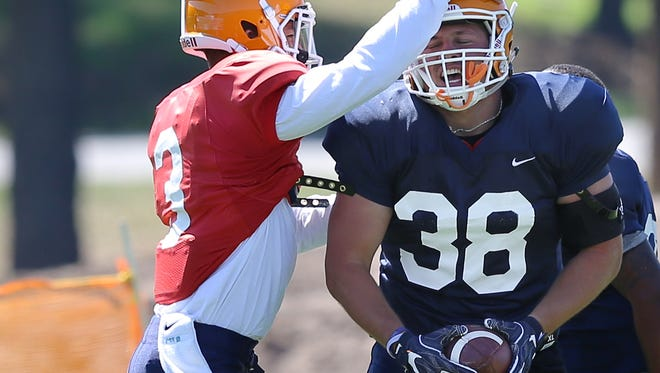UTEP fullback Winston Dimel, No. 38, celebrates his touchdown with quarterback Mark Torrez during their practice in early August at Camp Ruidoso.