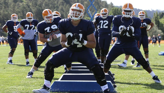 UTEP offensive linemen work on a shuffle drill during Wednesday's practice at Camp Ruidoso.