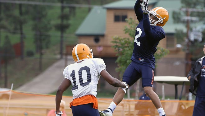 UTEP's Terry Juniel catches a pass over defensive back Khalil Rashaad-Brown during practice Aug. 10 at Camp Ruidoso.