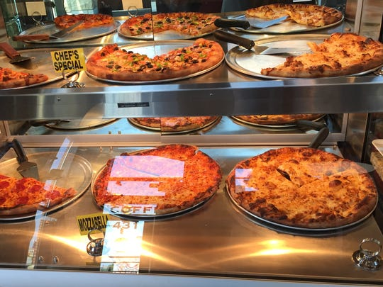 Pizzas on display at 1872 Cafe
