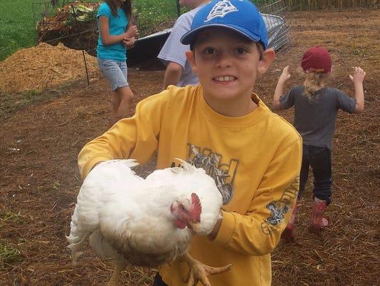 635487017636697358-Boy-with-Chicken