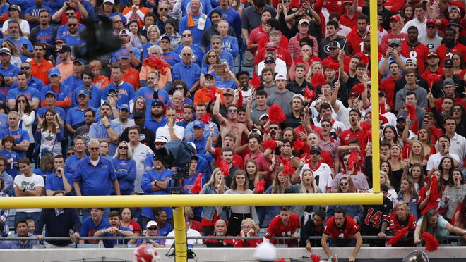 Georgia fans make nose for their team defense in the first half of a NCAA football game between Georgia and Florida in Jacksonville, Fla., on Saturday, Nov. 2, 2019.