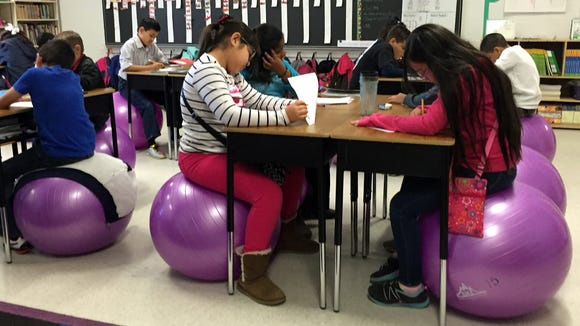Fourth-grade students in Sandy Conde's class take a