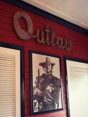 """We have a huge framed picture of Clint Eastwood, with a metal sign above that reads """"Outlaw."""""""