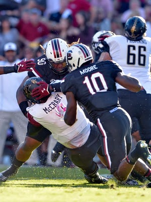 Vanderbilt quarterback Johnny McCrary is sacked by South Carolina's Taylor Stallworth (90) and Skai Moore during the first half on Oct. 17, 2015.