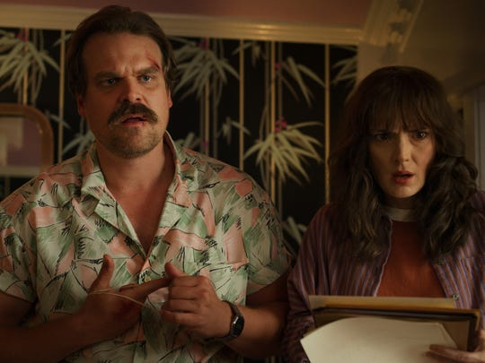 David Harbour, Winona Ryder in a scene from season