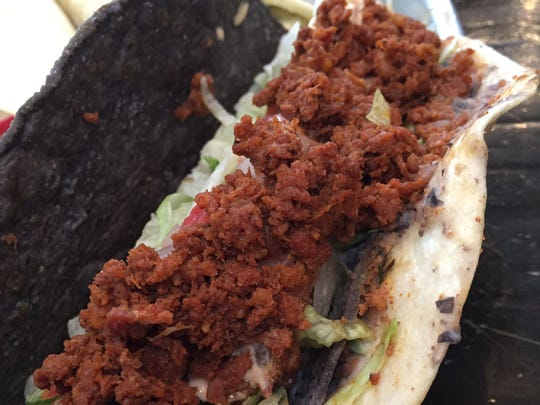 The taco royale at Taco Mamacita has crumbled chorizo on top of chicken, shredded lettuce, creamy black bean mash and chipotle cream sauce.