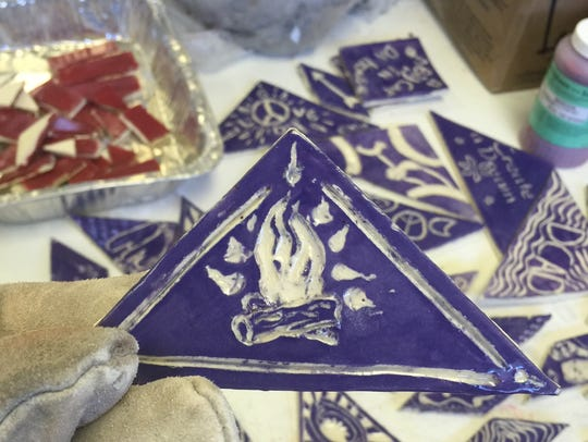 A camp fire highlights one tile in the Christna Cultural