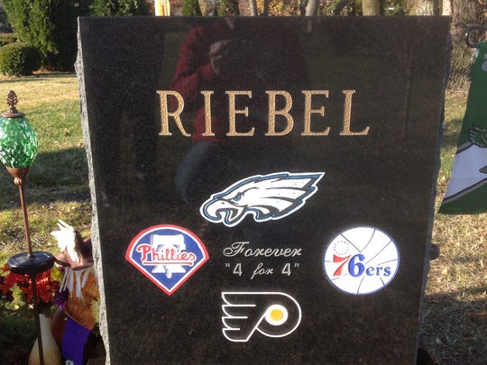 The gravestone of Colin Riebel, who died of a heroin overdose in November 2013 after becoming addicted to prescribed painkillers