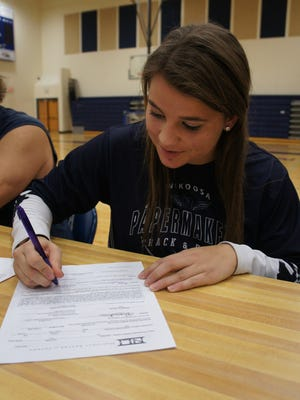 Nekoosa senior Kaylee Jensen signs her national letter of intent to compete in track and field at Winona State Friday at the high school.