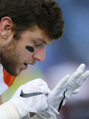 Cincinnati Bengals tight end Tyler Eifert inspects a snow flake prior to the game between the Bengals and the Buffalo Bills on Oct. 18.