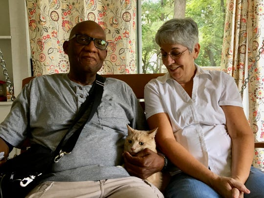 Tom and Gail Davis sit inside their enclosed porch with their cat Bezoar in their Staunton home on Thursday, July 19, 2018. They will be married 31 years in October. Tom has been on the wait list for a heart transplant at UVA Health Systems for one year. The average wait time in our region is one to three years.