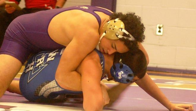 Garfield sophomore Derek Abreu (top) battling in a 170-pound match at the Garfield Holiday Tournament on Dec. 18.