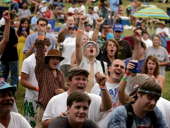 Fans roar at the end of a blues performance at the