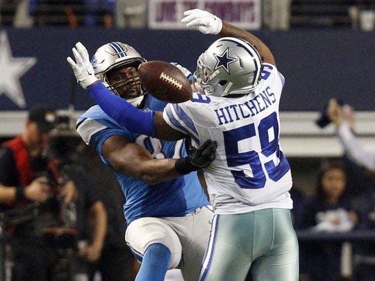 Cowboys linebacker Anthony Hitchens gets hit in the back by a pass to Lions tight end Brandon Pettigrew in the fourth quarter of a wildcard playoff game at AT&T Stadium on Jan. 4, 2015. The Cowboys beat the Lions, 24-20.