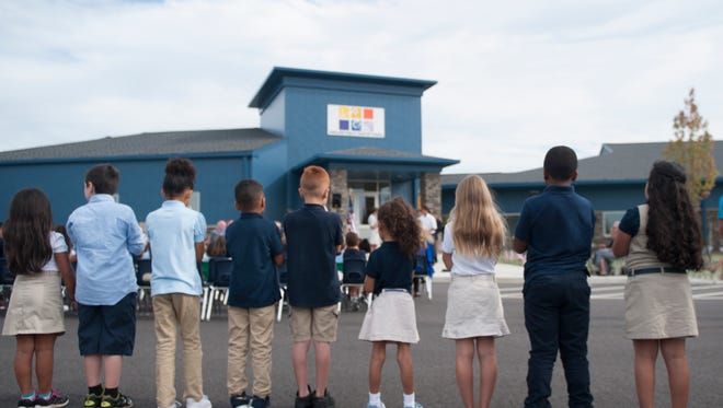Kids stand outside in formation, Friday, Sept , 22, 2017,  during the Ribbon Cutting Ceremony for the new Vineland Public Charter School, Vineland. N.J.