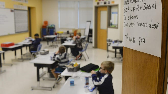 Socially distanced desks in a classroom at Godley Station School. On Monday, a select group of students and teachers returned to hybrid learning at Savannah-Chatham Public Schools. The school board approved moving forward with the third phase of return on Wednesday.