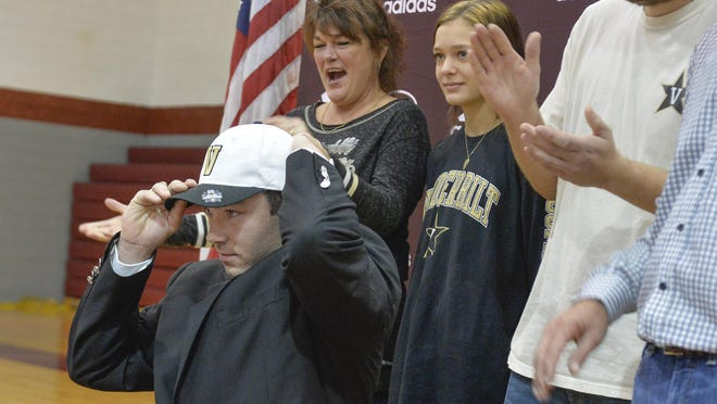 Carter Holton tries on the Vanderbilt cap after signing  a letter of intent at a ceremony Monday at Benedictine.