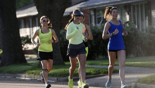 Elizabeth Venrick, right, leads Susie Patrick, from left, Cynthia Mickelson and RuthAnn Venrick on a run Wednesday morning.