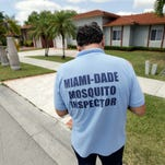 Giraldo Carratala, an inspector with the Miami Dade County mosquito control unit, walks door to door while responding to a resident's complaint about mosquitoes in the neighborhood Tuesday. Health officials are concerned about the spread of the Zika virus in the U.S., and they still need more money to fight the mosquitoes that spread it. (AP Photo/Lynne Sladky) ORG XMIT: OTK