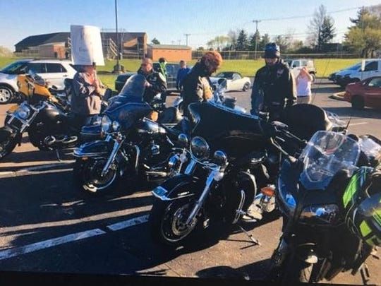 Motorcyclists escort a student, whose mom says he is bullied on the bus, to school in the Kings Local School District on Tuesday.