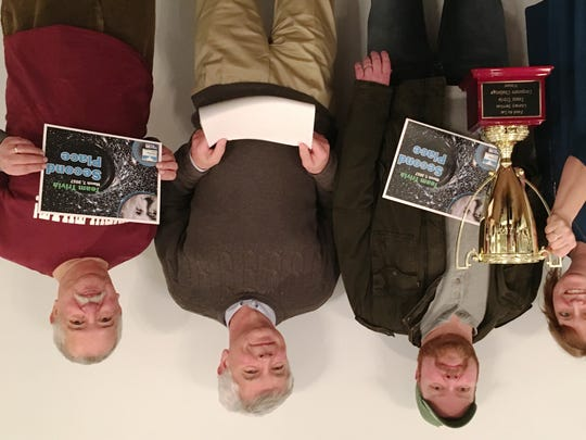 Cujak's Wine and Coffee Bar team I Knew That took home the new corporate challenge traveling trophy at Fond du Lac Literacy Services' Team Trivia event. Team members, from left are: Sara Cujak, Pat Jahn, John Nicoud and Carlos Marquez.