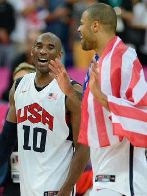 Aug. 11, 2012; London; USA guard Kobe Bryant (10) celebrates with USA center Tyson Chandler (4) after winning the gold in the men's basketball final against Spain in the London 2012 Olympic Games at North Greenwich Arena.