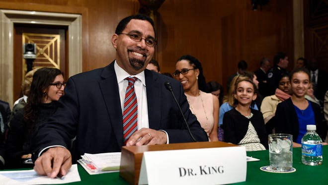 Acting Education Secretary Dr. John King, Jr., second from left, sits down to testify before the Senate Health, Education, Labor and Pensions Committee on Capitol Hill in Washington, Thursday, Feb. 25, 2016, during his confirmation hearing as the Education Secretary as his wife Melissa, third from right, and daughters Mireya, second from right, and Amina, right, watch.  (AP Photo/Susan Walsh)