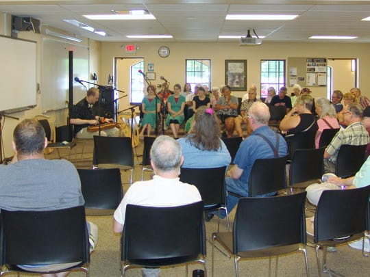 Musician Jason Fawks performs for a crowd during a mini concert in the lower level at COTC during the 44th annual Coshocton Dulcimer Days Festival.