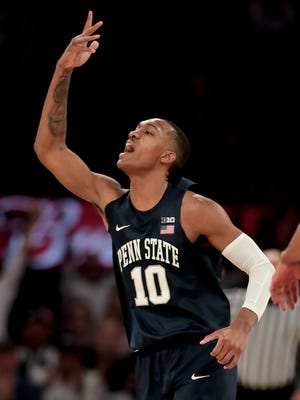 Penn State guard Tony Carr  reacts after hitting a 3-point shot against Utah during the first quarter of an NCAA college basketball game for the NIT championship Thursday, March 29, 2018, in New York. (AP Photo/Julie Jacobson)