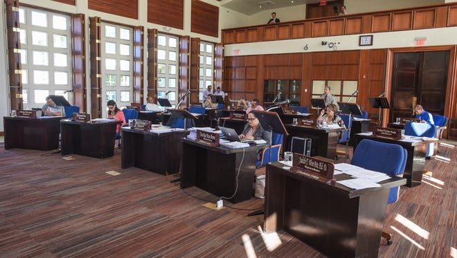 This Dec. 29, 2016, file photo shows lawmakers at a legislative session. Employees and senatorial staff of the 34th Guam Legislature should receive their first paycheck of the new term by the middle of next week, according to Executive Director Jermaine Alerta.